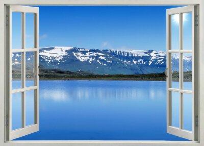 Naklejka Otwórz okno panoramiczny widok na góry śniegu i jeziora