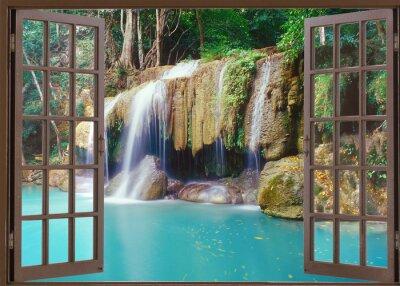 Naklejka Otwórz okno widoku do głębokiej dżungli wodospad