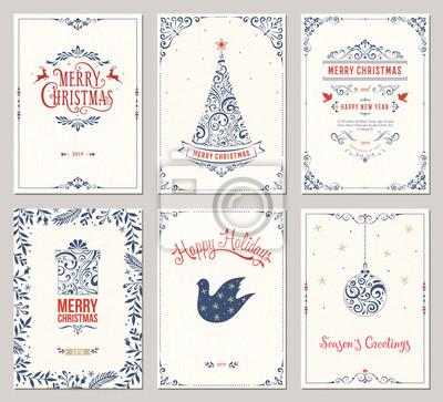 Ozdobne zimowe kartki z życzeniami z drzewem noworocznym, szkatułką, ozdoby choinkowe, ramki wirowe i projekt typograficzny.