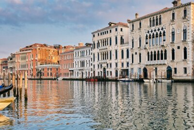 Palace in Venetian style on the Grand Canal in sunrise time. Venice, Italy.