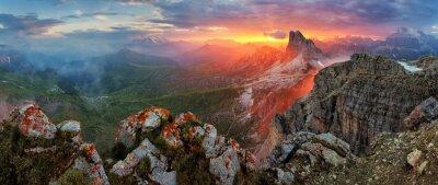 Naklejka Panorama dramatic sunset in dolomites alp mountain from peak Nuv