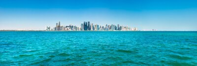 Naklejka Panorama of city of Doha, Qatar downtown with skyscrapers, view from sea bay