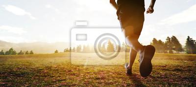 Naklejka panoramic - man running marathon through the field