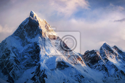 Naklejka Panoramic view of beautiful snowy Masherbrum peak in Karakoram mountain range during sunset light