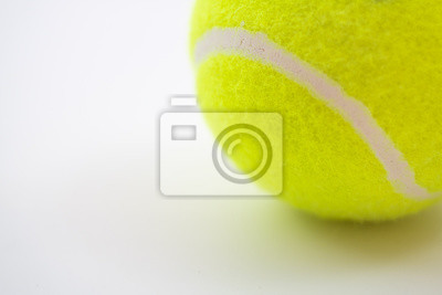 part of new yellow tennis ball on white background, copy space on left