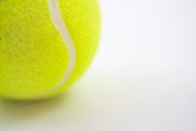 part of new yellow tennis ball on white background, copy space on right