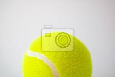 part of new yellow tennis ball on white background, copy space on top