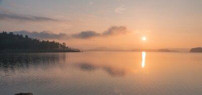Naklejka peaceful sunrise over lake
