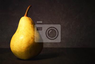 Naklejka Pear on dark grunge background. Still life with juicy pear