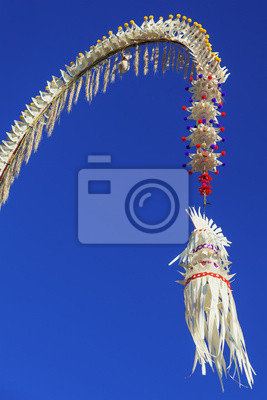 Penjor - house, temple traditional  Balinese symbol and decoration for Galungan hindu religious ceremony, holidays, art festivals. Asian culture tours, backgrounds and details of tropical island Bali