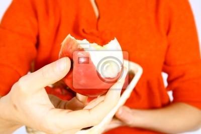 Naklejka Piękna dziewczyna z jabłkiem na białym