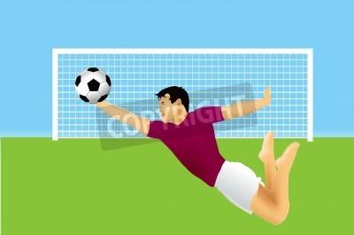 Piłka nożna bramkarz skacze na piłkę.