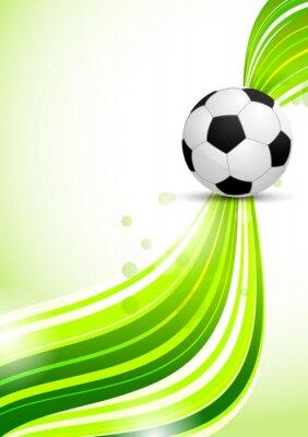 Piłka nożna na zielonym tle