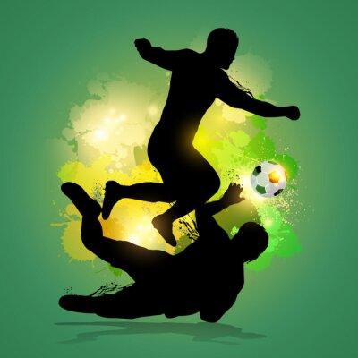 piłkarz drybluje przez bramkarza