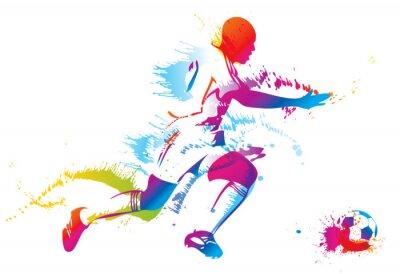 Piłkarz kopie piłkę