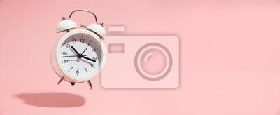 Naklejka Pink Alarm clock on pastel pink background.