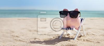 Naklejka Pink Piggybank On Deck Chair Over The Sandy Beach