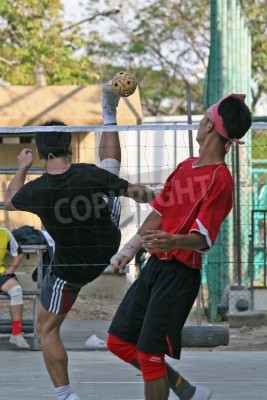 Player makes a high overhead kick in Sepak Takraw (Kick Volleyball). The game is a cross between soccer and volleyball and is popular in Thailand, Malaysia and Indonesia.