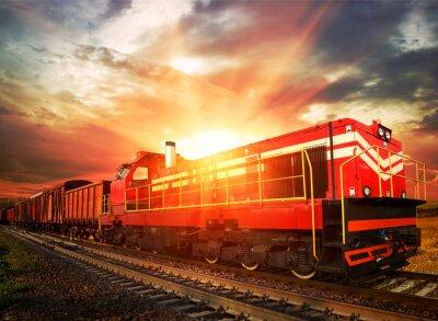 Naklejka Pociąg towarowy w porannym słońcu