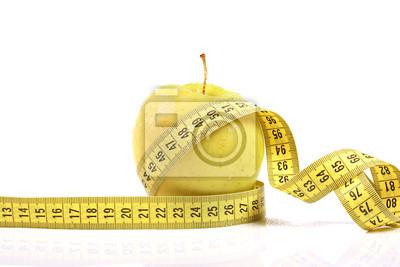Pojęcie diety. jabłko z taśmy pomiarowej