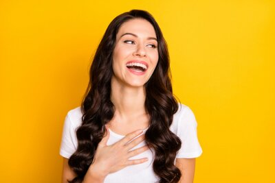 Naklejka Portrait of attractive cheerful wavy-haired girl laughing having fun joke 1 April isolated over bright yellow color background