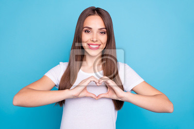 Portrait of her she nice-looking attractive lovely lovable cheerful cheery tender straight-haired lady showing heart isolated over bright vivid shine blue green teal turquoise background
