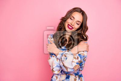 Portrait of her she nice-looking attractive lovely sweet gentle pretty winsome lovable cheerful cheery wavy-haired lady hugging herself closed eyes isolated over pink pastel background
