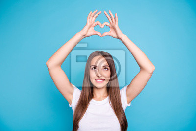 Portrait of her she nice-looking attractive tender sweet lovely lovable cheerful cheery straight-haired lady showing rising heart up isolated on bright vivid shine blue green teal turquoise background