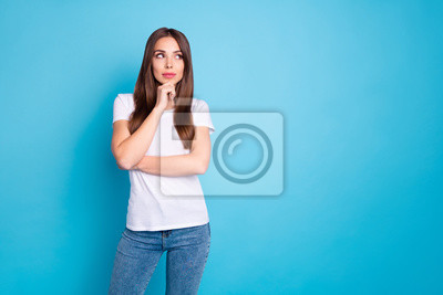 Portrait of nice-looking attractive lovely lovable curious sweet straight-haired girlfriend thinking creating new plan copy space isolated over bright vivid shine blue green teal turquoise background