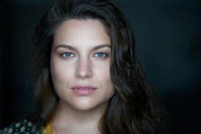 Portrait of pretty woman dark hair, blue eyes.
