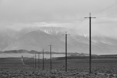 Naklejka power lines stretching across the empty and desolate California desert