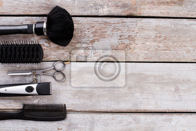 Naklejka Professional hairdresser tools. Combs, hair brushes, scissors and electric trimmer. Space for text.