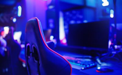 Naklejka Professional place streamer video gamers room with computer. Cyber sport championship neon color lights