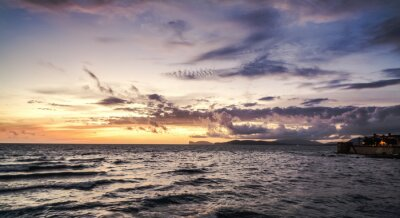 Purple sky over Alghero seafront at sunset