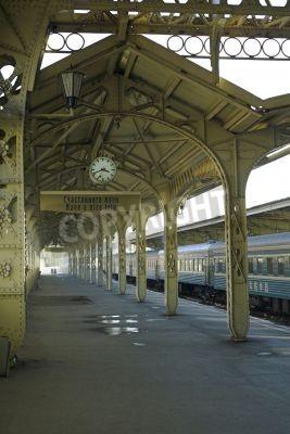 Naklejka Railroad station - 5 - Railroad station platform with a hanging clock,