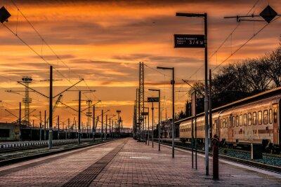 Naklejka Railroad Station Platform Against Sky During Sunset