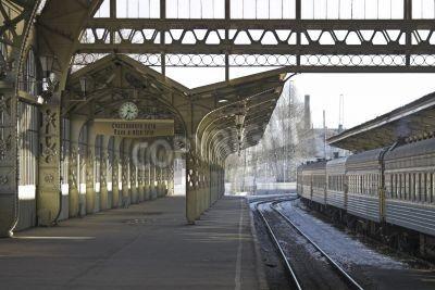 Naklejka Railroad station platform with a hanging clock and