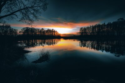 Reflections off a vivid Sunset sky over a Lake