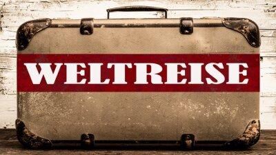 Naklejka REISEN HINTERGRUND - Alter rustikaler vintage Koffer mit rotem Banner und weißem Schriftzug