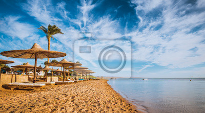 Naklejka Relax under parasol on the beach of Red Sea, Egypt