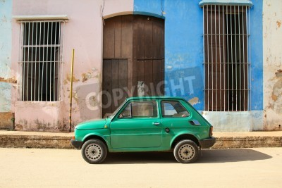 Naklejka REMEDIOS, CUBA - FEBRUARY 20: Old Polish car Fiat 126 on February 20, 2011 in Remedios, Cuba. New change in law allows Cubans to trade cars. Cars in Cuba are very old because of the old law.