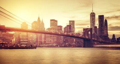 Naklejka Retro stylizowane Manhattan na zachodzie słońca, New York, USA.