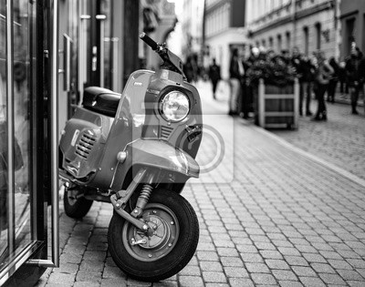 RIGA, LATVIA - SEPTEMBER 8: Vespa scooter (motoroler) on September 8, 2014 in Riga, Latvia. Vespa is an Italian brand of scooter manufactured by Piaggio.
