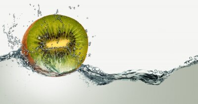 Naklejka Ripe fruit of kiwi and sparks of water.
