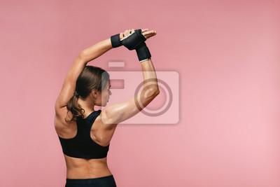 Naklejka Rozciągać. Sport kobiety rozciąganie Przed Trenować