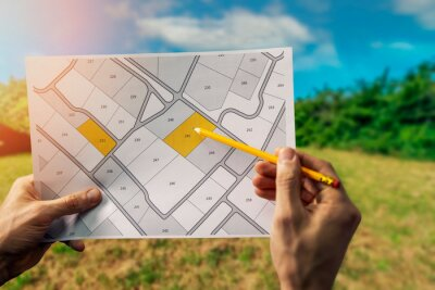 Naklejka sale of building plot of land for house construction. cadastral map on field background