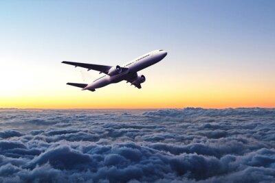 Naklejka Samolot na niebie o świcie