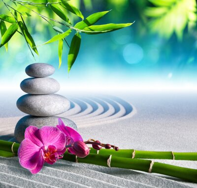 Naklejka sand, orchid and massage stones in zen garden