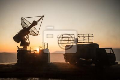 Naklejka Satellite dishes or radio antennas against evening sky. Selective focus