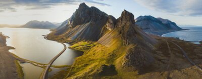 Naklejka scenic road in Iceland, beautiful nature landscape aerial panorama, mountains and coast at sunset